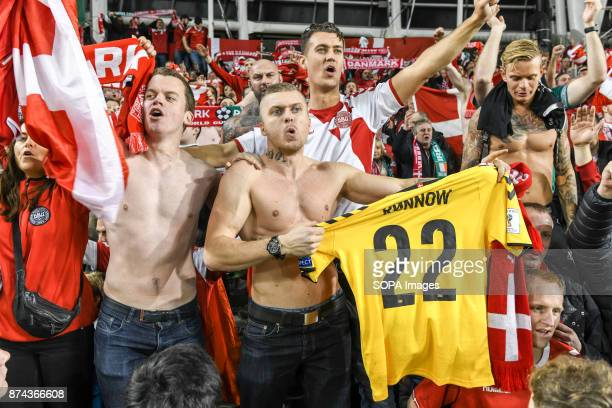 Denmark fans celebrate during the FIFA World Cup 2018 qualification Play off football match between Republic of Ireland and Denmark at the Aviva...