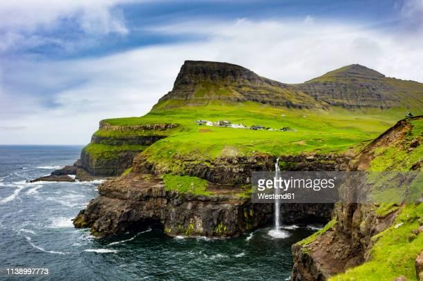 denmark, faroe islands, vagar, gasadalur waterfall - islas faroe fotografías e imágenes de stock