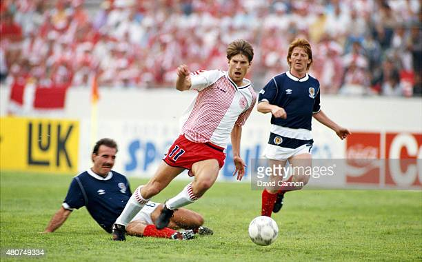 Denmark forward Michael Laudrup is challenged by Willie Miller and Gordon Strachan during the FIFA 1986 World Cup match between Denmark and Scotland...