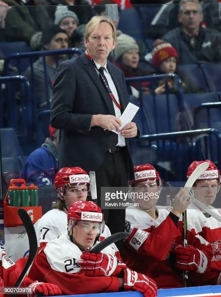 Denmark head coach Olaf Eller on the bench in the second period against Finland during the IIHF World Junior Championship at KeyBank Center on...