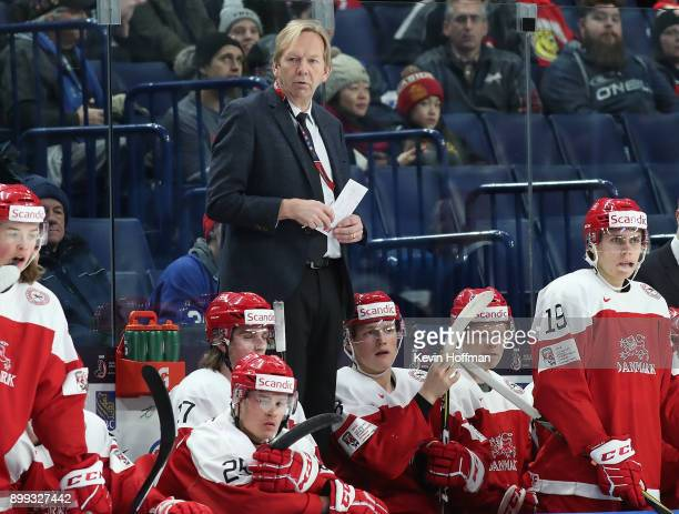 Denmark head coach Olaf Eller watches play in the second period against Finland during the IIHF World Junior Championship at KeyBank Center on...