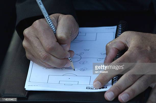 Denmark manager Keld Bordinggaard makes notes during the UEFA European Under21 Championship Group A match between Denmark and Belarus at the Aarhus...