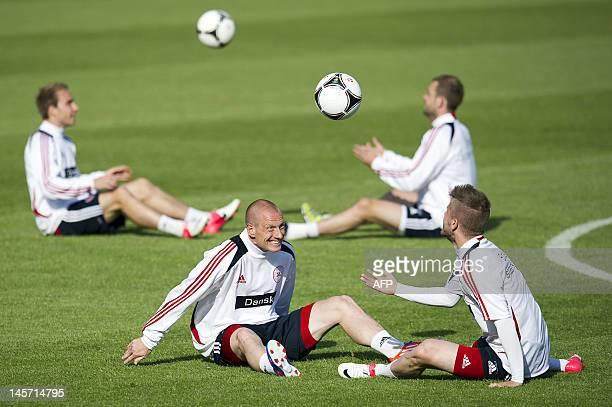 Denmark national football team midfielders Niki Zimling and Lasse Schone attend a training session at Kolobrzeg's municipal stadium on June 4 five...