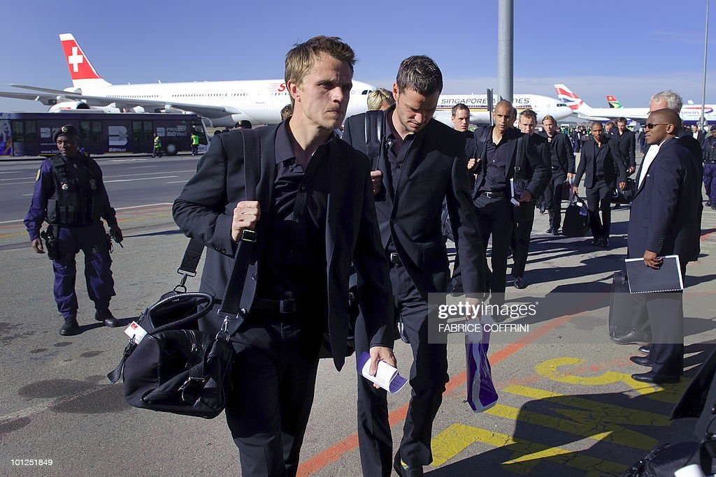 Denmark national football team players carry their luggage upon their arrival at O. R. Tambo international airport on May 29, 2010 in Johannesburg ahead of the 2010 FIFA World Cup in South Africa.