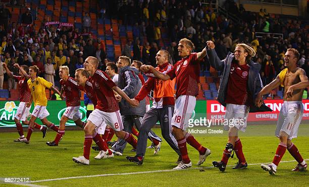 Denmark players celebrate after their 1-0 victory at the final whistle in the FIFA2010 World Cup Qualifying Group 1 match between Sweden and Denmark...