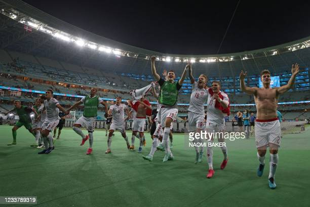 Denmark players celebrate their victory at the end of the UEFA EURO 2020 quarter-final football match between the Czech Republic and Denmark at the...