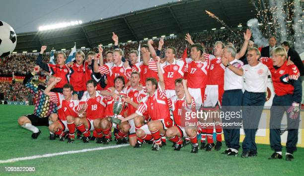 Denmark players celebrate with the trophy after the UEFA Euro 1992 Final between Denmark and Germany at the Ullevi on June 26, 1992 in Gothenburg,...