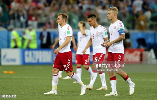 Denmark players look dejected following the 2018 FIFA World Cup Russia Round of 16 match between Croatia and Denmark at Nizhny Novgorod Stadium on...