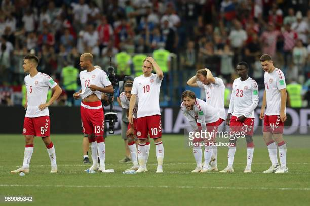 Denmark players look dejected following their sides defeat in the 2018 FIFA World Cup Russia Round of 16 match between Croatia and Denmark at Nizhny...