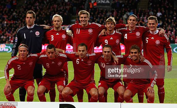 Denmark players pose for a group photograph after the national anthem during the FIFA 2010 group one World Cup Qualifying match between Denmark and...