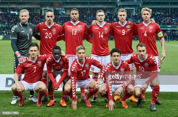 Denmark pose for a group photo prior to the match back row fr Left Kasper Schmeichel Yussuf Yurary Poulsen Mathias Zanka Jorgensen Henrik Dalsgaard...