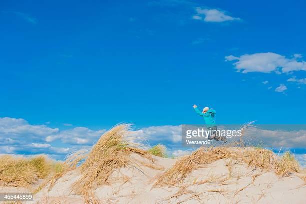 Denmark, Romo, Boy jumping at North Sea