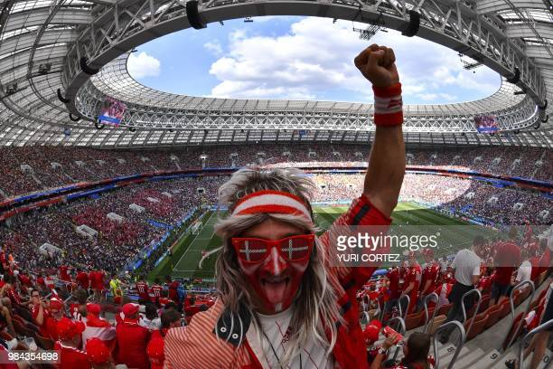 TOPSHOT Denmark supporters prepare for the Russia 2018 World Cup Group C football match between Denmark and France at the Luzhniki Stadium in Moscow...