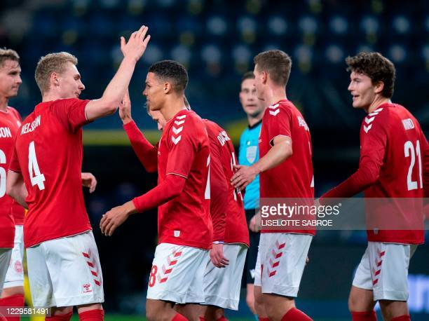Denmark's Alexander Bah is congratulated by teammates after scoring the 2-0 and cheers with Victor Nelsson during the international friendly football...