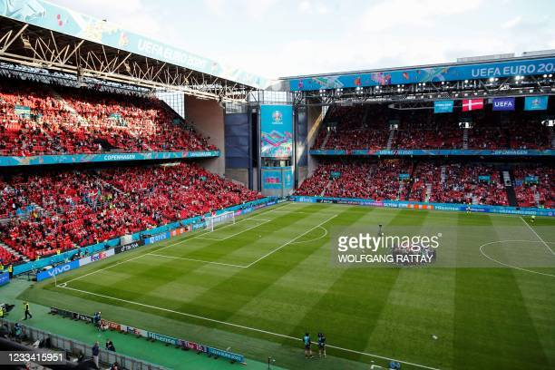Denmark's and Finland's players huddle as the UEFA EURO 2020 Group B football match between Denmark and Finland was to resume after being suspended...