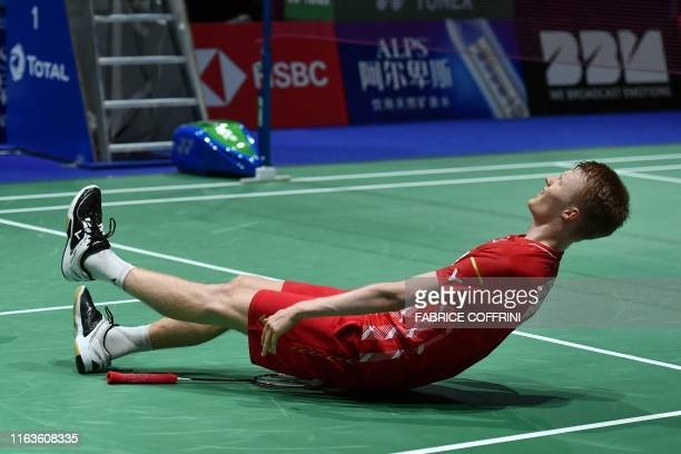 Denmark's Anders Antonsen celebrates his victory over Thailand's Kantaphon Wangcharoen during the men's singles semi-final match at the BWF Badminton...