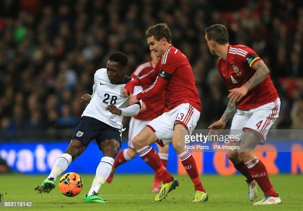 Denmark's Andreas Bjelland and England's Danny Welbeck battle for the ball