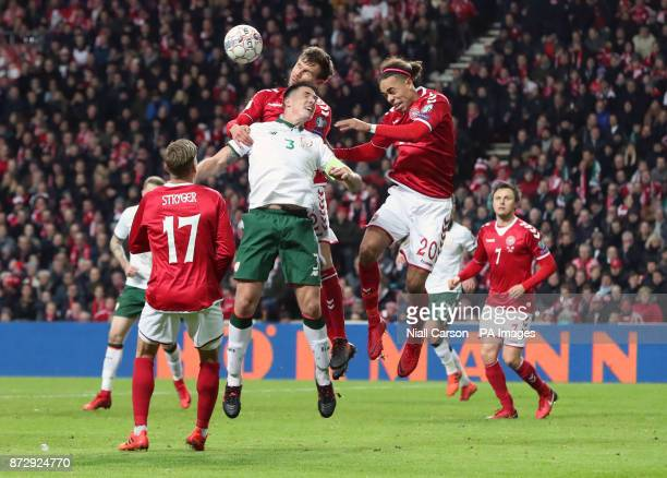 Denmark's Andreas Bjelland and Yussuf Poulsen combine to challenge Republic of Ireland's Ciaran Clark during the FIFA World Cup qualifying playoff...