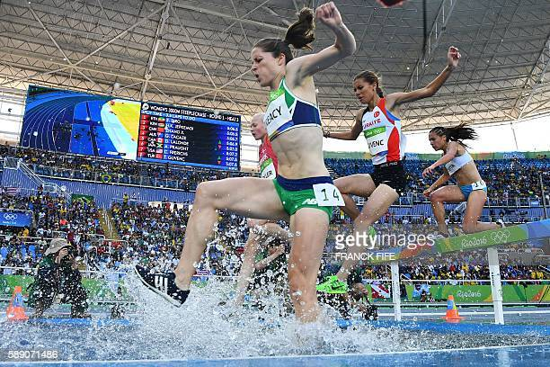 Denmark's Anna Emilie Moller, Ireland's Sara Louise Treacy, Turkey's Tugba Guvenc and Argentina's Belen Casetta compete in the Women's 3000m...