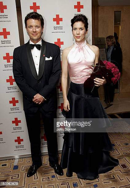 Denmark's Australian born Crown Princess Mary and her husband Crown Prince Frederik pose for photos as they arrive at the 90th anniversary gala...