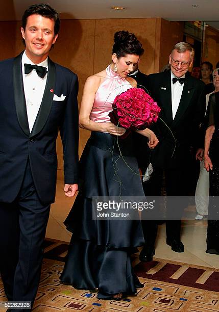 Denmark's Australian born Crown Princess Mary and her husband Crown Prince Frederik arrive at the 90th anniversary gala dinner for the Australian Red...