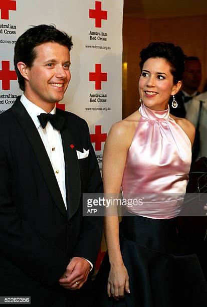 Denmark's Australian born Crown Princess Mary arrives with her husband Crown Prince Frederik at the 90th anniversary gala dinner for the Australian...