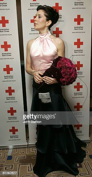 Denmark's Australian born Crown Princess Mary poses for photos as she arrives at the 90th anniversary gala dinner for the Australian Red Cross on...