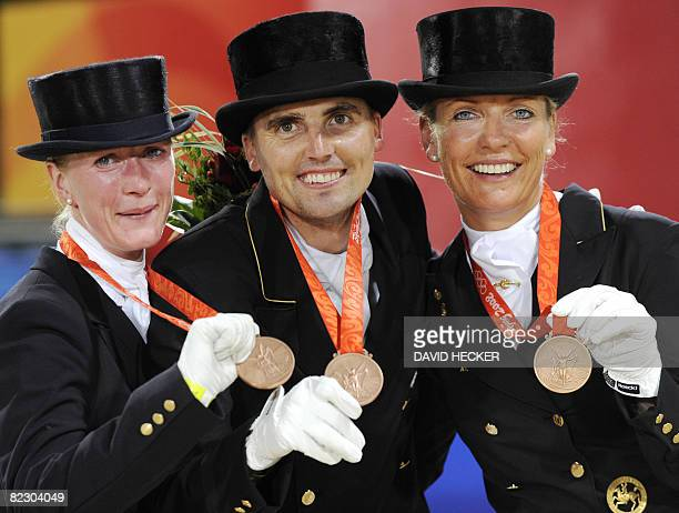 Denmark's bronze medalists in the equestrian Team Dressage of the 2008 Beijing Olympic Games Nathalie zu SaynWittgenstein Anne vaan Olst and Andreas...