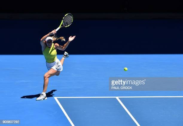 Denmark's Caroline Wozniacki hits a return against Croatia's Jana Fett during their women's singles second round match on day three of the Australian...