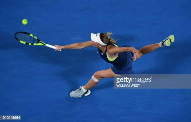 Denmark's Caroline Wozniacki hits a return against Romania's Simona Halep during their women's singles final match on day 13 of the Australian Open...