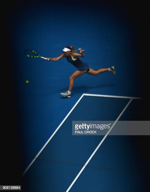 Denmark's Caroline Wozniacki hits a return against Slovakia's Magdalena Rybarikova in their women's singles fourth round match on day seven of the...