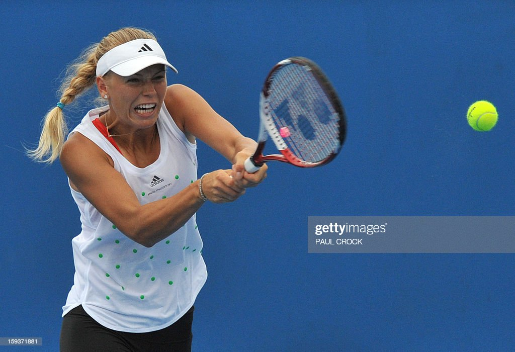 Denmark's Caroline Wozniacki hits a return during a training session ahead of the Australian Open tennis tournament in Melbourne on January 13, 2013.