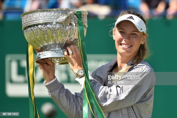 TOPSHOT Denmark's Caroline Wozniacki holds the winner's trophy after her Women's singles finals match against Belarus's Aryna Sabalenka at the ATP...