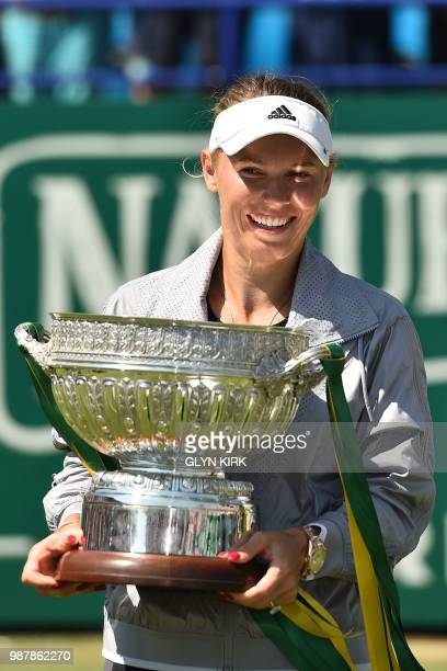 Denmark's Caroline Wozniacki holds the winner's trophy after her Women's singles finals match against Belarus's Aryna Sabalenka at the ATP Nature...
