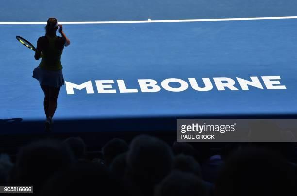 Denmark's Caroline Wozniacki prepares to serve against Croatia's Jana Fett during their women's singles second round match on day three of the...