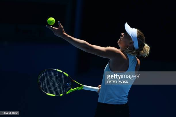 Denmark's Caroline Wozniacki prepares to serve during a practice session ahead of the Australian Open tennis tournament in Melbourne on January 14...
