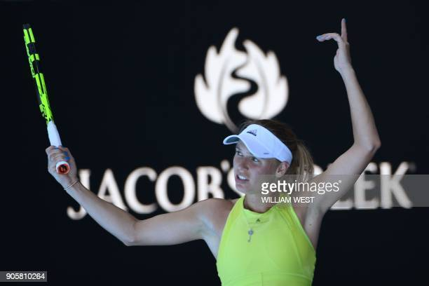 Denmark's Caroline Wozniacki reacts after a point against Croatia's Jana Fett during their women's singles second round match on day three of the...