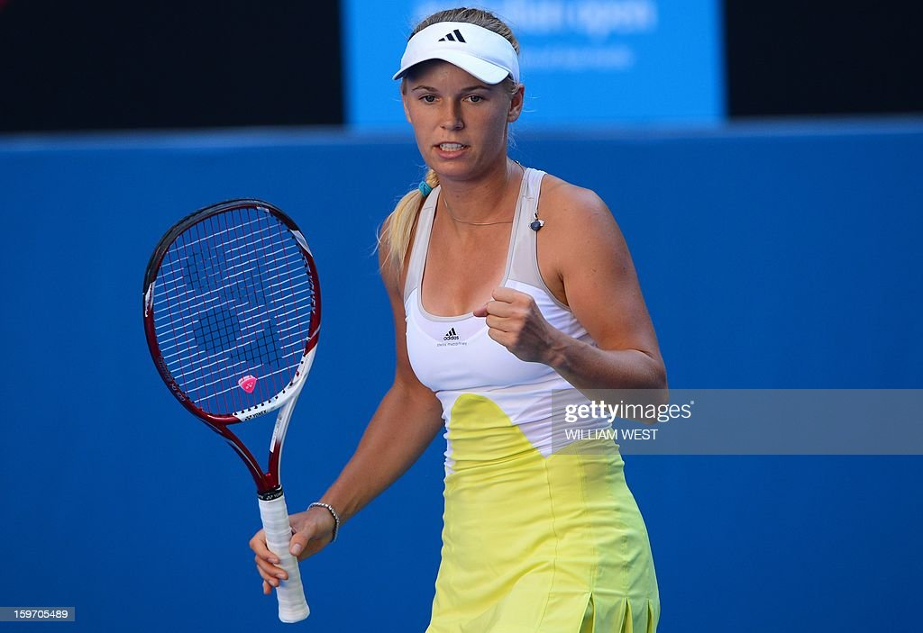 Denmark's Caroline Wozniacki reacts after a point against Ukraine's Lesia Tsurenko during their women's singles match on day six of the Australian Open tennis tournament in Melbourne on January 19, 2013.