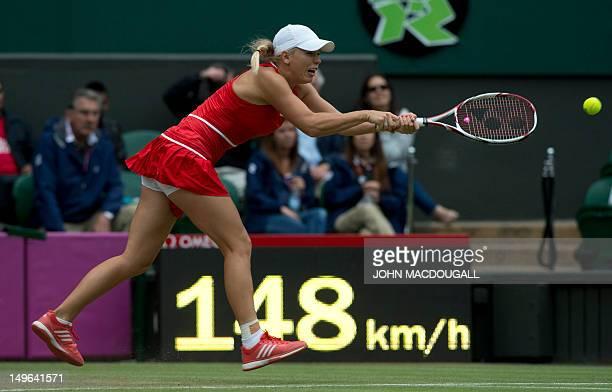 Denmark's Caroline Wozniacki returns a shot to Slovakia's Daniela Hantuchova in the women's singles tennis match at the 2012 London Olympic Games at...