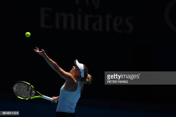 Denmark's Caroline Wozniacki serves during a practice session ahead of the Australian Open tennis tournament in Melbourne on January 14 2018 / AFP...