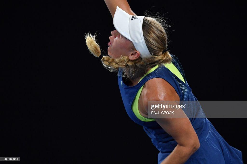 TOPSHOT - Denmark's Caroline Wozniacki serves during their women's singles quarter-finals match against Spain's Carla Suarez Navarro on day nine of the Australian Open tennis tournament in Melbourne on January 23, 2018. / AFP PHOTO / Paul Crock / -- IMAGE