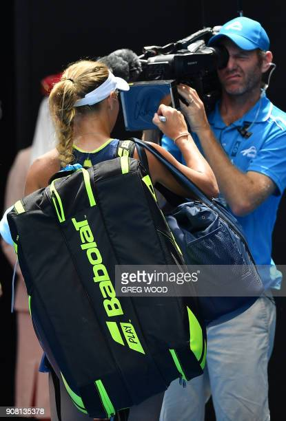 Denmark's Caroline Wozniacki signs her autograph for broadcast as she celebrates beating Slovakia's Magdalena Rybarikova in their women's singles...
