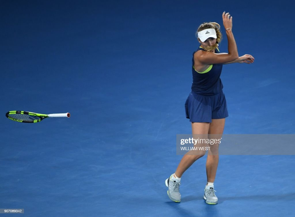 TOPSHOT - Denmark's Caroline Wozniacki throws her racquet during their women's singles third round match against Netherland's Kiki Bertens on day five of the Australian Open tennis tournament in Melbourne early January 20, 2018. /