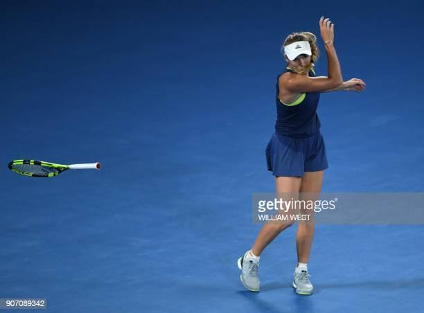 TOPSHOT Denmark's Caroline Wozniacki throws her racquet during their women's singles third round match against Netherland's Kiki Bertens on day five...