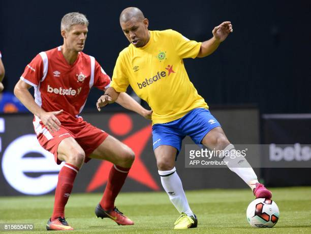 Denmark's Chris Sorensen vies with Brazil's Djalminha during the Star Sixes semifinal football match between Denmark and Brazil at the O2 Arena in...