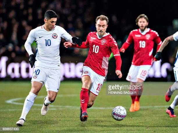 Denmark's Christian Eriksen and Chile's Pedro Pablo Hernandez vie for the ball during their international friendly football match between Denmark and...