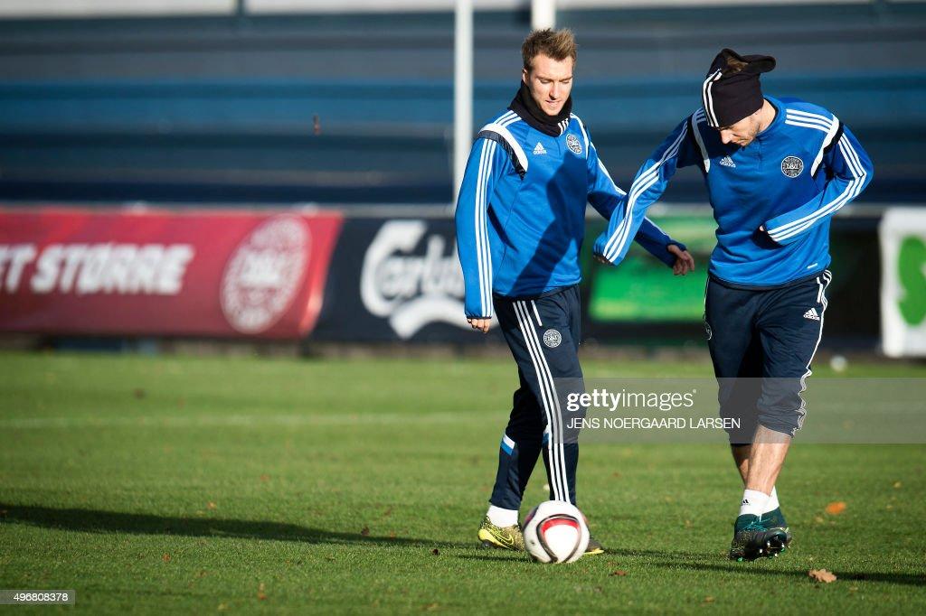 Denmark's Christian Eriksen (L) and Nicklas Bendtner attend a training session in Helsingor, Denmark, on November 12, 2015. Denmark will play against Sweden in the Euro 2016 play-off in Stockholm on November 14 and in Copenhagen on November 17.