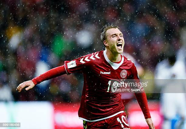 Denmark's Christian Eriksen celebrates scoring during the World Cup 2018 football qualification match between Denmark and Armenia in Copenhagen on...