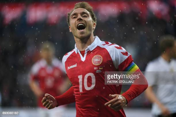 Denmark´s Christian Eriksen celebrates scoring the opening goal during the friendly football match between Denmark and Germany in Brondby Denmark on...