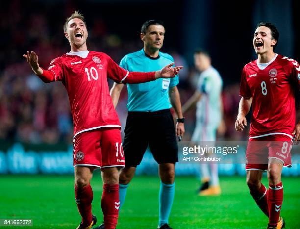 Denmark's Christian Eriksen celebrates with Thomas Delaney after scoring a goal during the 2018 FIFA World Cup qualifying football match Denmark vs...